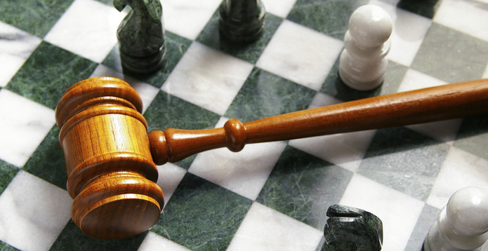 gavel on a chess board