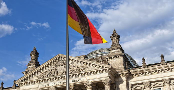 German flag flying on Bundestag building in Berlin