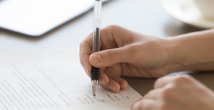 Hand signing legal document regulatory permission -695