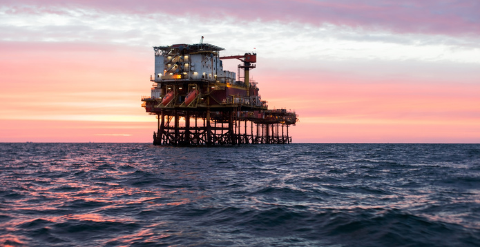Offshore oil platform sunset
