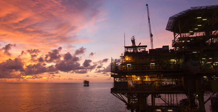 Oil and gas platform in South China Sea at sunset